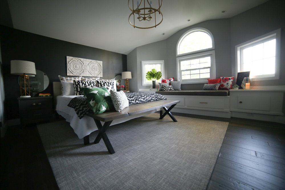 master bedroom, black accent wall, gold chandelier, master bedroom retreat, rustic bedroom, chic bedroom, gold lighting, french gold, black and white bedroom, window seat, bay window seat, ceiling tile art work, chicago ceiling tile, round mirrors, circle mirrors, grey rug, gray rug