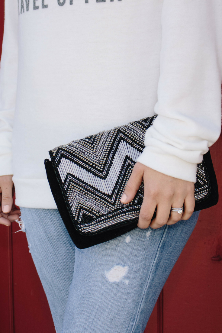 chevron sliver and black clutch with distressed denim