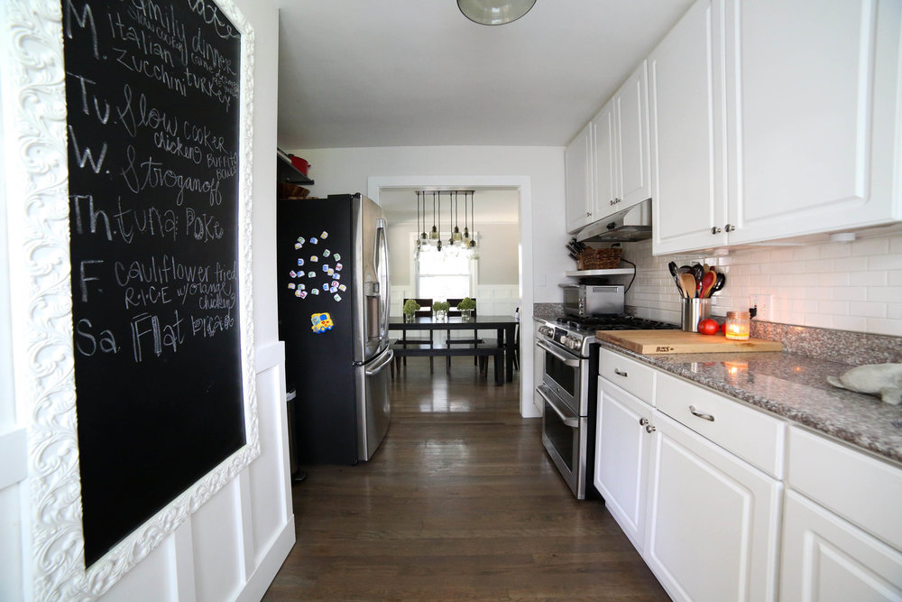 chalk board wall, built in chalk board, white kitchen, subway tile, galley kitchen, stainless, all white kitchen, kitchen makeover