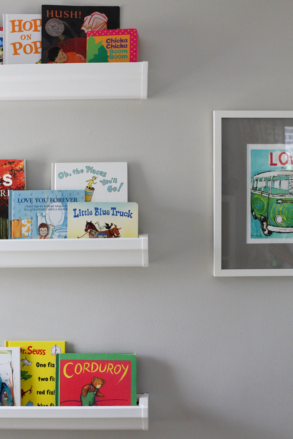 how to add character to any kids room, bookshelf, rain gutter bookshelf, rain gutter bookshelves, art work, pete the cat art work, kids picture books