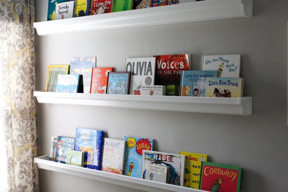 how to make bookshelves, how to add character to any kids room, bookshelf, rain gutter bookshelf, rain gutter bookshelves, art work, pete the cat art work, kids picture books