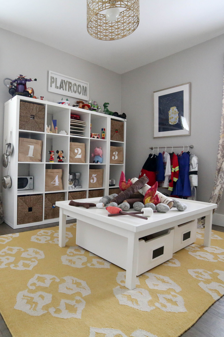 how to add character to any kids room, how to add character to any kids room, playroom, kids playroom, storage bins, play kitchen, pretend play, wall mural, black and white playroom, numbered storage bins, how to add character to any kids room, toy storage, number bins, toys, how to store toys, playroom, kids room, storage, toy storage, how to add character to any kids room, bookshelf, rain gutter bookshelf, rain gutter bookshelves, art work, pete the cat art work, kids picture books
