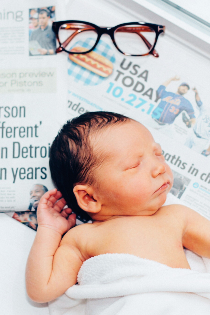 newborn photography, newborn newspaper, newborn photos, newspaper with a newborn