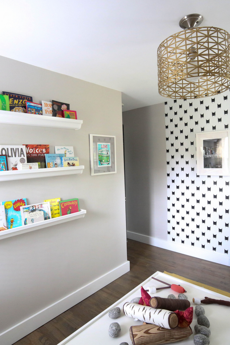 how to add character to any kids room, playroom, kids playroom, storage bins, play kitchen, pretend play, wall mural, black and white playroom, numbered storage bins