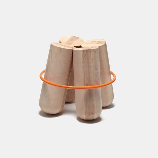 The Bolt stool's solid wooden legs are elegantly bound with a colourful metal ring
