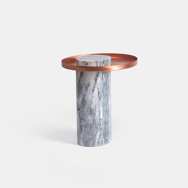 The Salute occasional table mixes marble and metal for visual impact