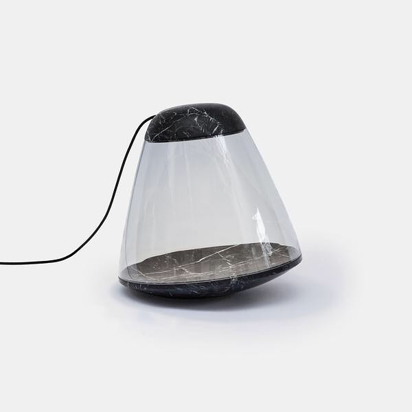 The Apollo lamp combines pure blown glass with dense, elegant marble