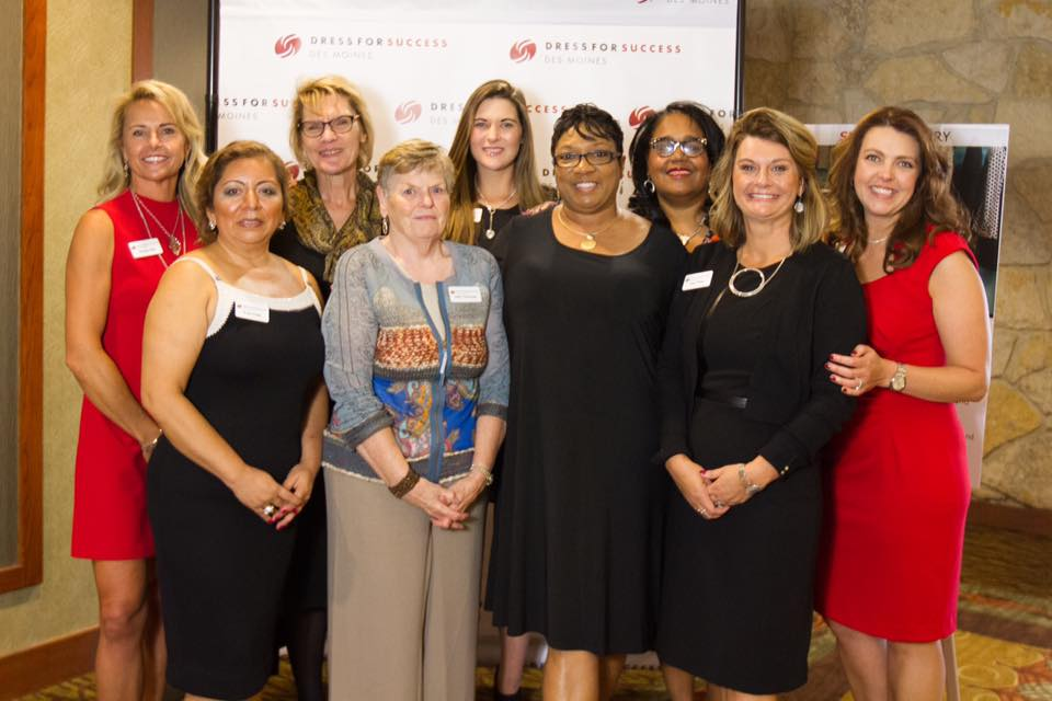 The board of dress for Success - Des Moines with special guest Lynn at the Success Luncheon 2016. Photo credit Richelle Smith.  Pictured left to right Teresa Choi, Irma Ariza, Judy Kendzora, Judy Corcoran, Sara Jacobson., Lynn Gilkey, Renee Hardman, Jody White and Christine Osborne