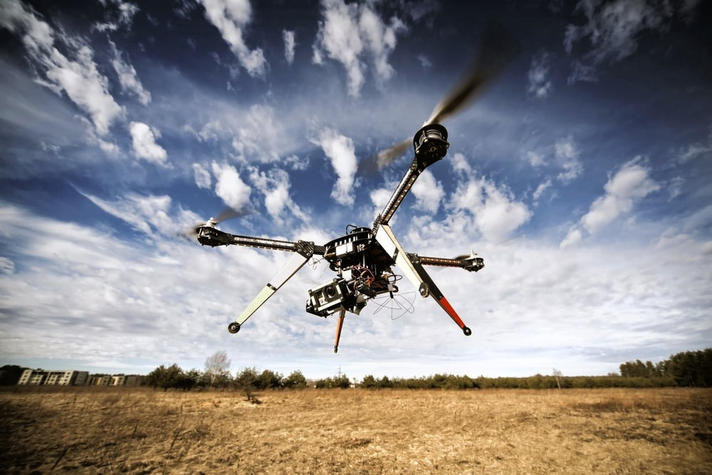 bigstock-Quadrocopter-drone-flying-in-t-61077359.jpg