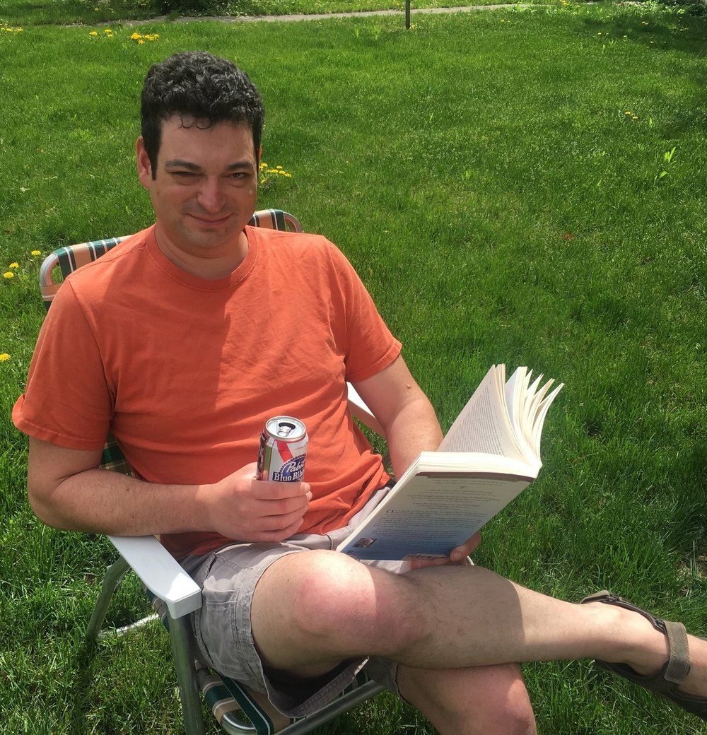 Alex Babat - Alex was spotted enjoying the first best spring day here in Missoula with a good book and a cold beverage...What are you reading, Alex?