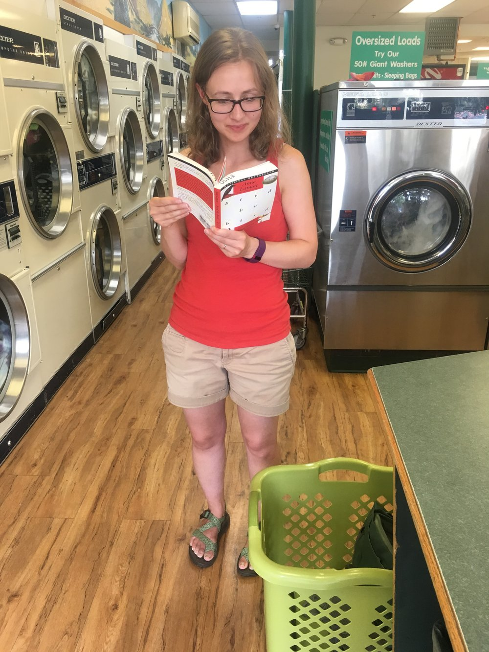 This is not a staged photo... - Ashley was standing up in front of the bank of dryers at the Green Hanger Laundromat in Missoula with a book in her hand, smiling, when I snapped this photo, asking for permission later.  (Thankfully she said yes.)  What was so compelling she couldn't put it down during her dryer's last three minutes?  Bird by Bird, by Anne Lamott.