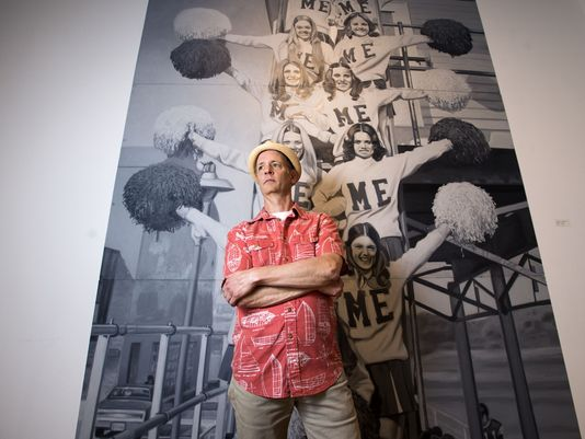"""Artist Rich Harrington in front of his oil painting """"Varsity"""" at the Anthony Brunelli Fine Arts Gallery in Binghamton. Harrington's installation titled, """"This is the way we play and learn"""", will be on display until June 25th."""
