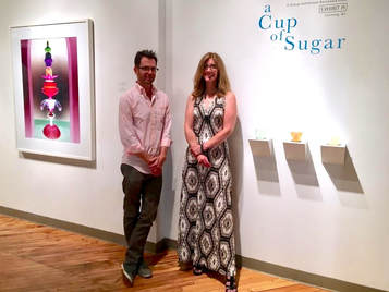 Anthony Brunelli Fine Arts director, John Brunelli, with Anne Welles, gallery director of Exhibit A at the  Cup of Sugar  opening.
