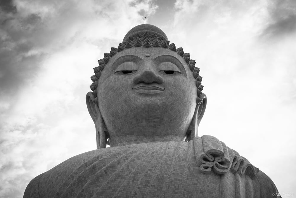 A closer look at the face of the Buddha in this 45 meter tall statue, keeping watch over Phuket, Thailand.   Gallery ID: BAW12