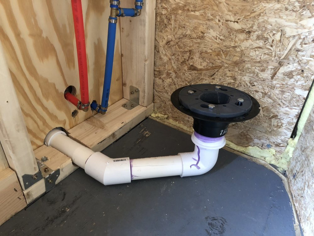 Shower almost ready to install - You'll notice there is no u-bend in the shower, we didn't have the clearance above to raise it even higher and we didn't want to put it under the floor. It works fine and gives the greywater tank a chance to breathe and won't create a negative pressure inside. It also doesn't smell as it is directly below our bathroom fan.