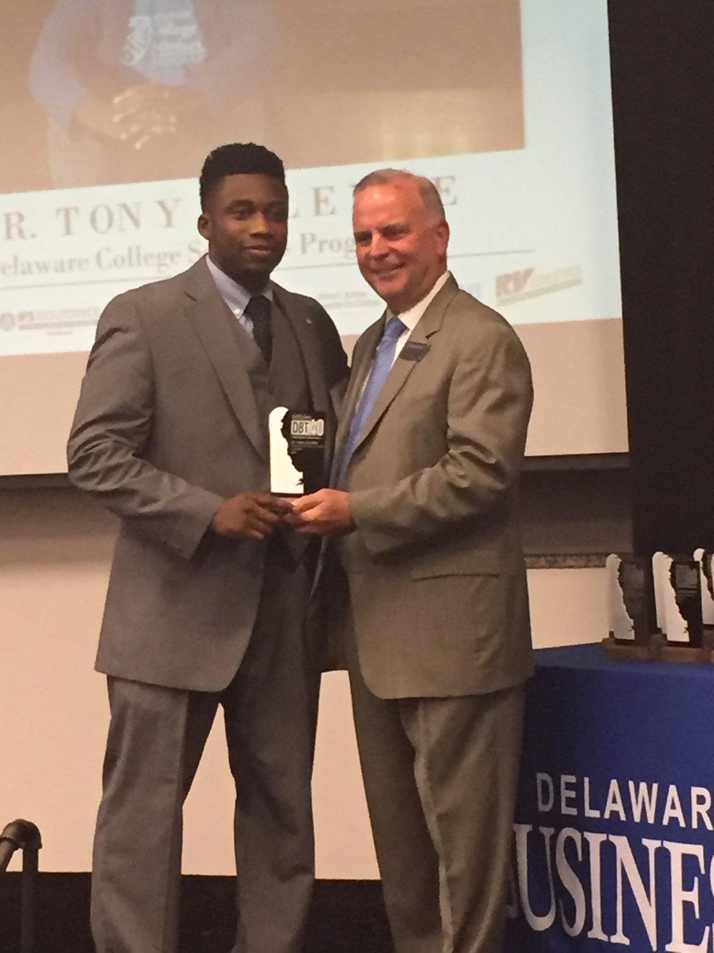 Dr. Tony Alleyne Accepts DBT 40 Under 40 Award.JPG