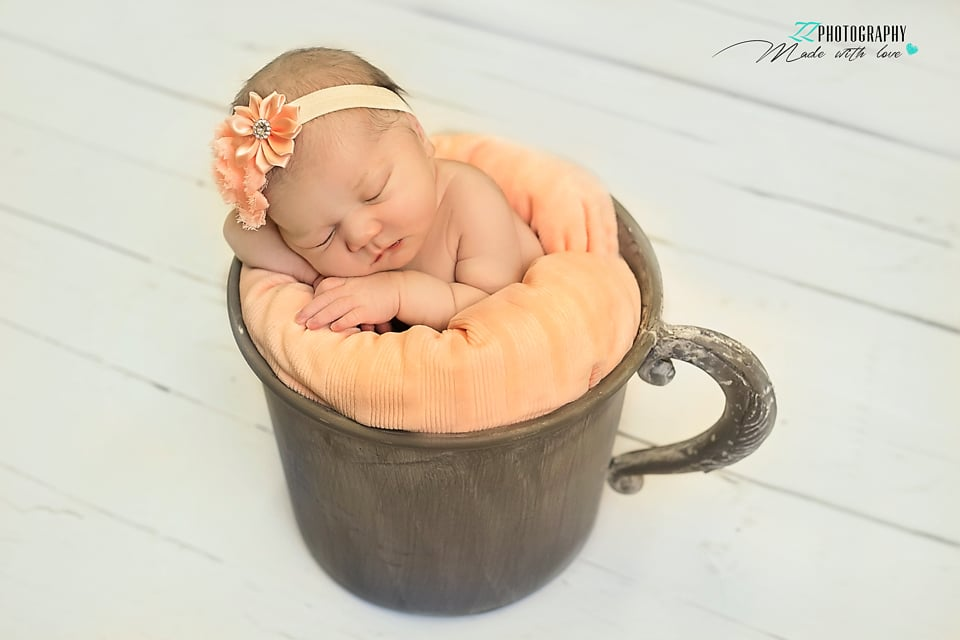 newborn girl in a cup