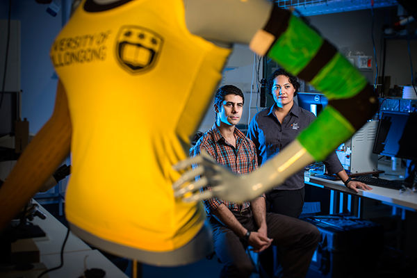 Dr Michael Weaver and Dr Sheridan Gho with their innovative 'Lymph Sleeve' prototype. Image courtesy of the University of Wollongong.