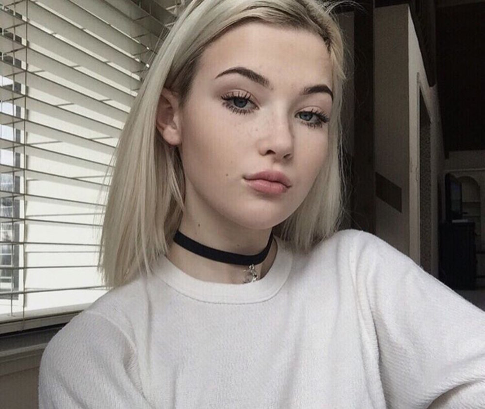 First off, how is this girl only 15? You would never be able to tell that she is the youngest of the group. Her signature makeup look consists of barely-there makeup and long lashes or porcelain skin and faux freckles.