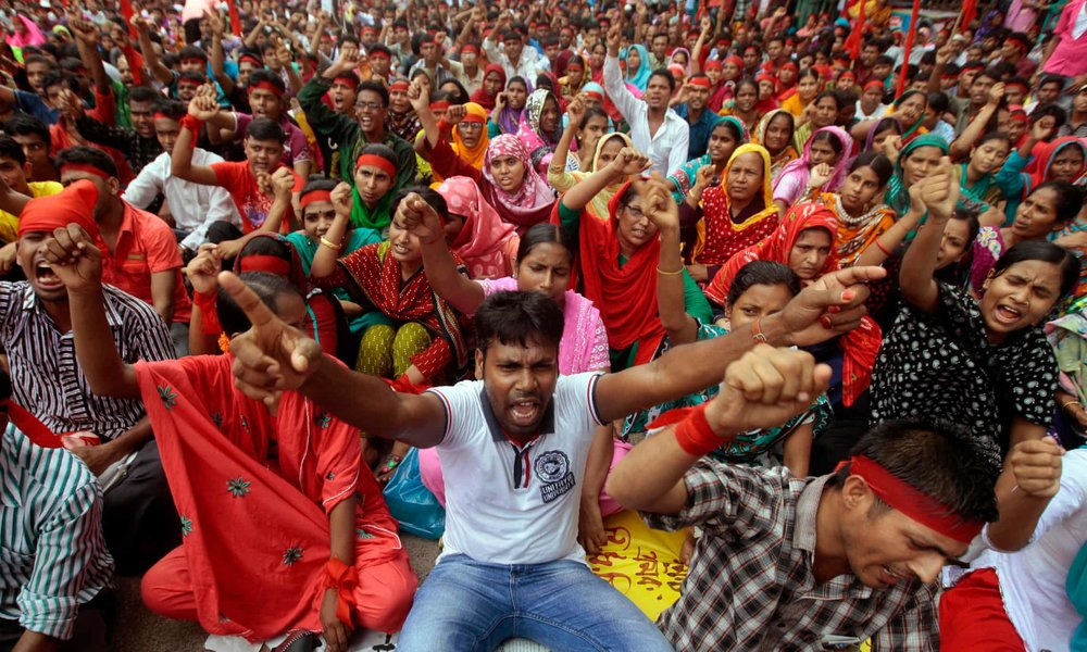 Garment workers in Dhaka protest following the Rana Plaza tragedy. Photo courtesy of The Guardian.