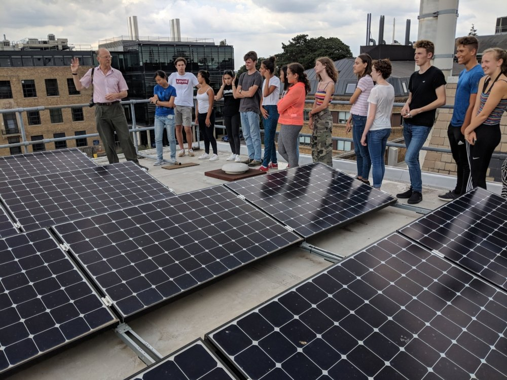 Inspecting the solar panels on the roof of the School of Geography and the Environment at Oxford University