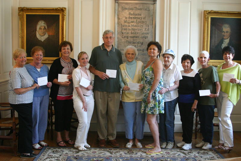 Newtown Woman's Club Finance Committee Chair Dolores Judge, left, and Club Tri-President Marie Sturdevant, second from left, presented checks to representatives from seven local organizations on June 25. Continuing left is Marg Studley, Samantha Flynn, Steve Bennett, Louise Andrews, Pat Murray, Shirley Glynn, Laura Hewitt, Barbara Lynch, and Beth Caldwell.