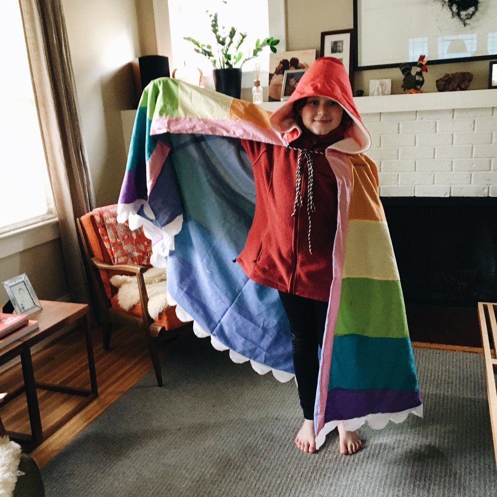 Benny's one-of-a-kind rainbow hooded cloak.