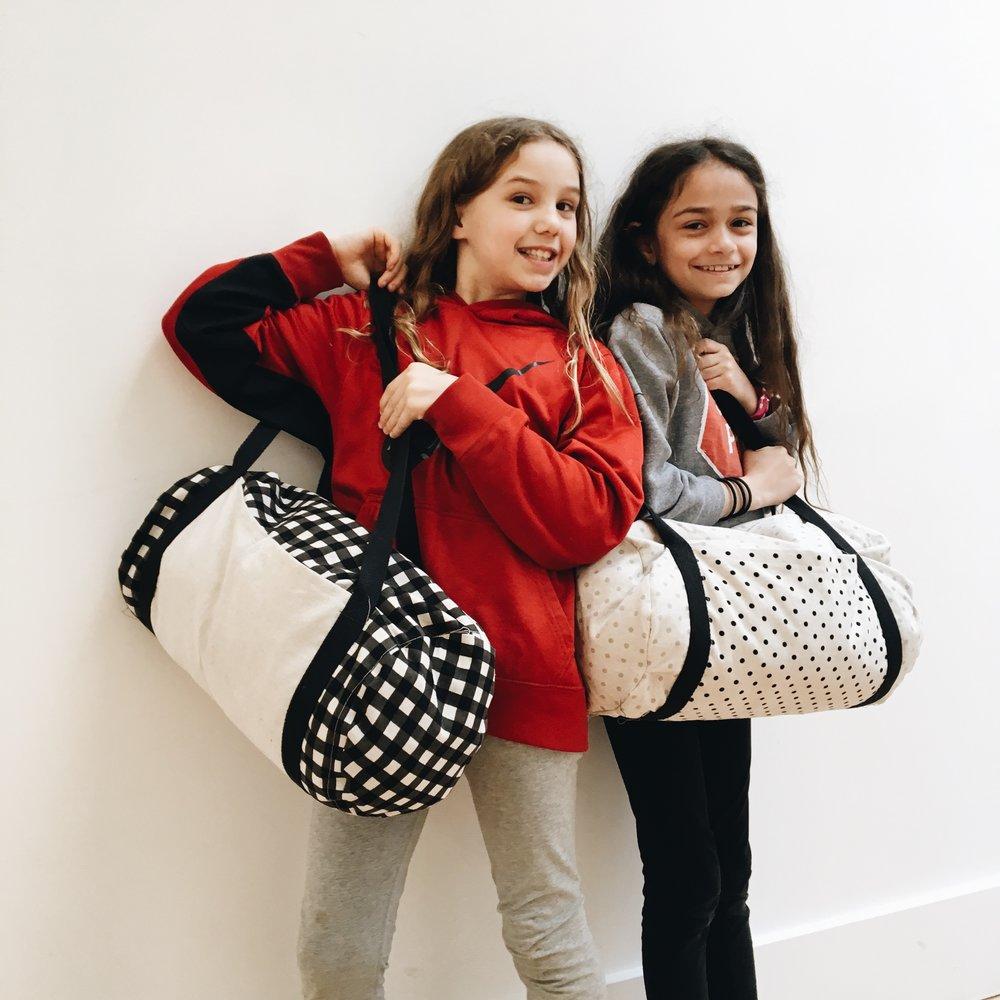 Tula's and Priya's duffle bags