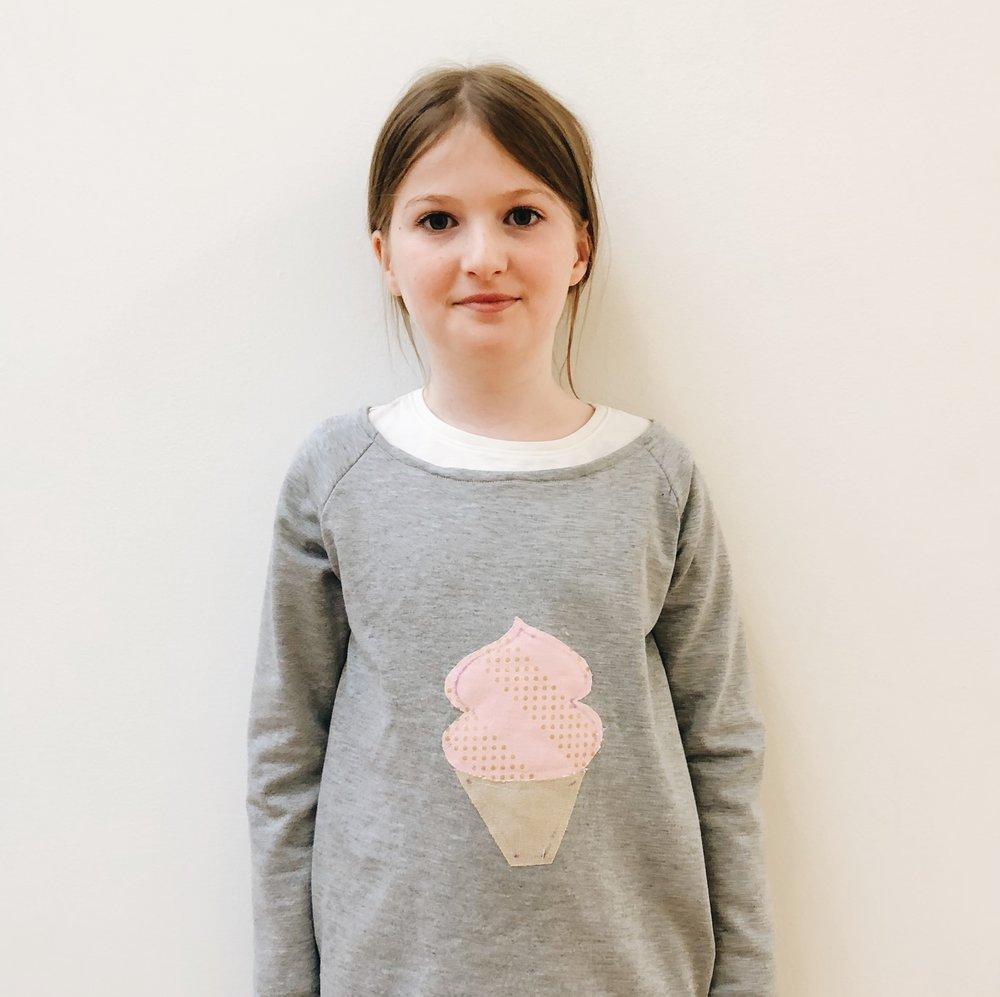 Caroiline's cupcake appliqué sweatshirt.