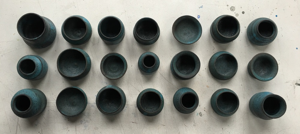 Mini pottery knoll in blue.