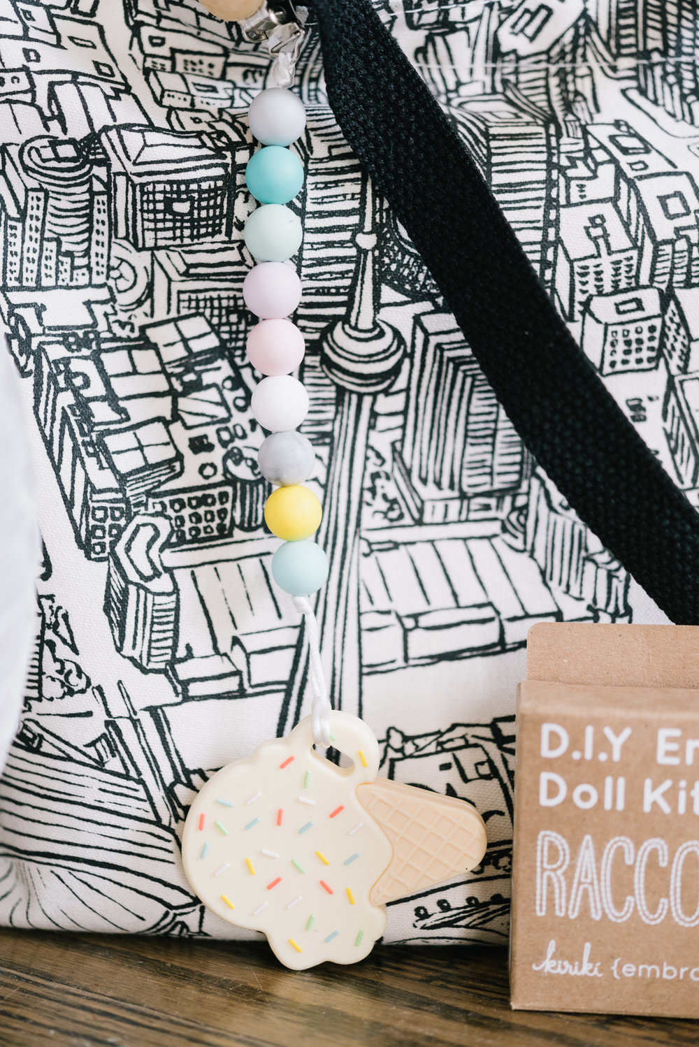 The cutest ice cream teether by Sweetie Pie Design Co ready to go on a Toronto skyline tote by Gotamago.