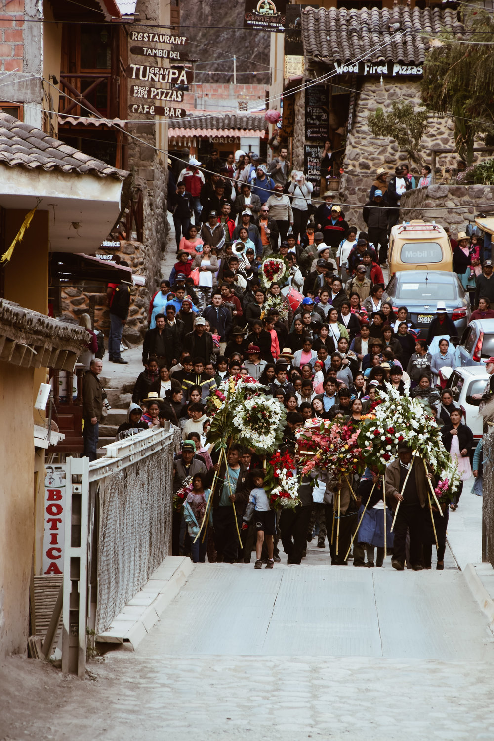 ^^ locals gathering for a funeral service in ollantaytambo