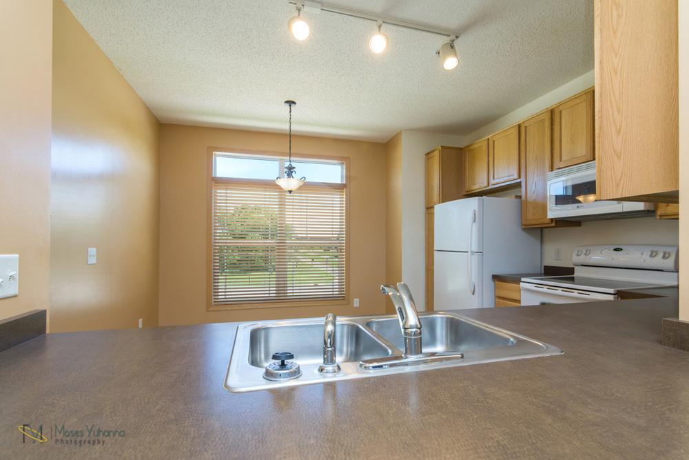 14627-Olivine-Terrace-NW-Ramsey-kitchen 4.jpg