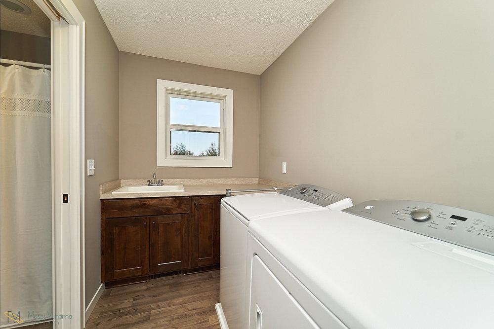 5938-151st-lane-nw-ramsey-mn-master-bedroom-laundry.jpg