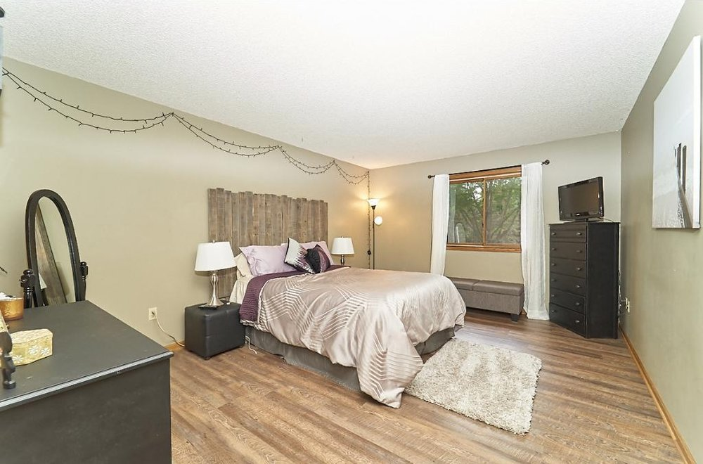 7701-n-york-lane-brooklyn-park-master-bedroom.jpg