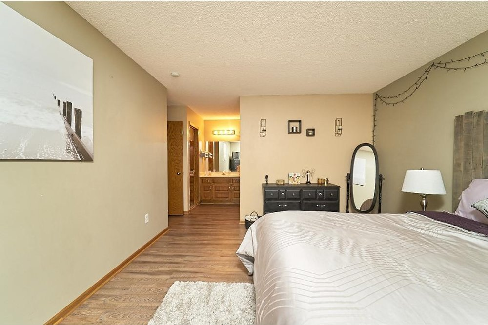 7701-n-york-lane-brooklyn-park-master-bedroom2.jpg
