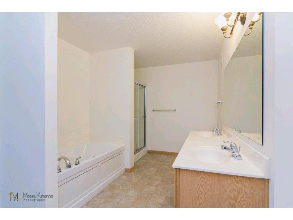 14627-olivine-terrace-nw-ramsey-mn-master-bathroom.jpg