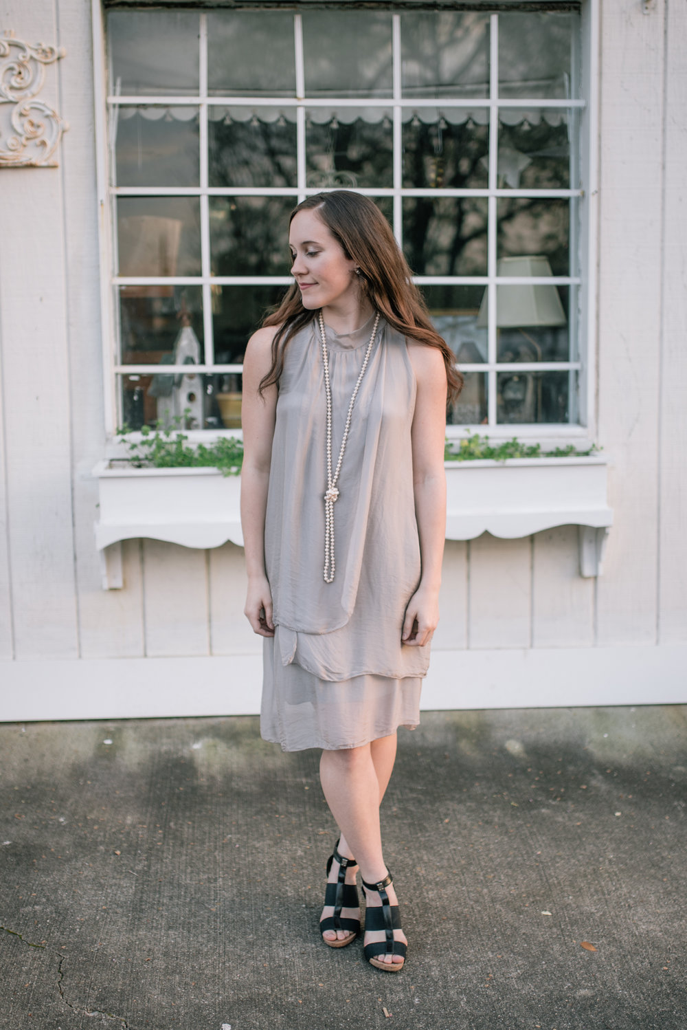Dress this silky piece up with heels and a nice necklace.  Dress: 76.00