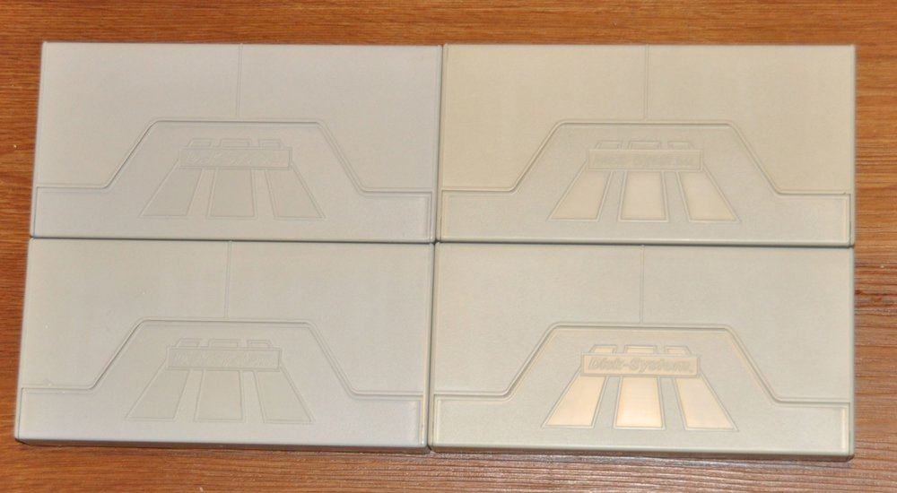Disk cases before and after retrobriting