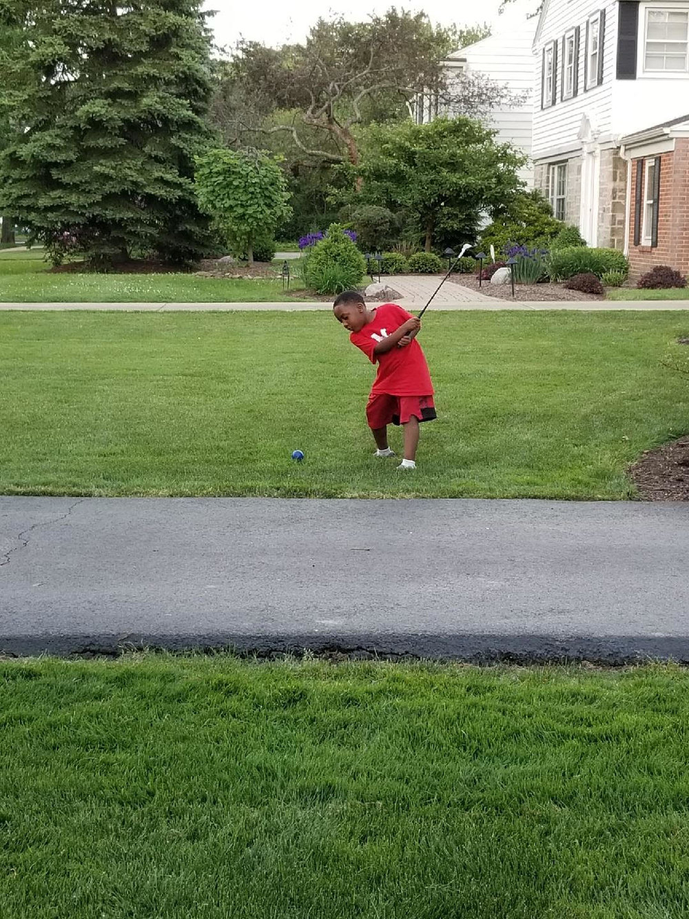 Charlie Sifford's great grandson, Gregory, practicing his swing. So glad Gregory likes CHARLIE TAKES HIS SHOT!