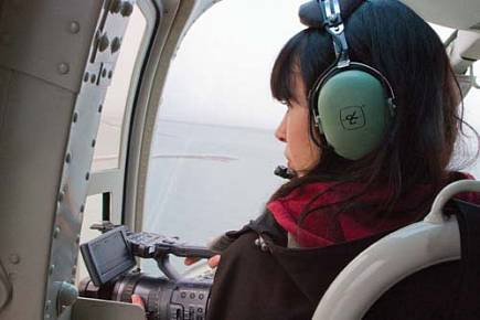 Tracy Burns works on her short film about erosion in Kaktovik from the air. Burns was one of a few dozen students between Kaktovik and Point Lay to take part in filmmaking workshops. Photo: Maeva Gauthier