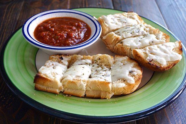 Melted mozzarella on garlic bread with a side of our house made marinara sauce. #JimmysKouzina