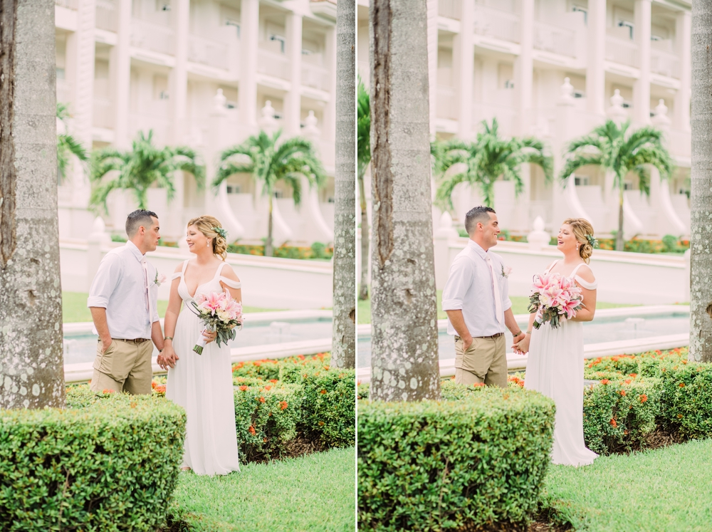 Destination Wedding Photography_Riu Palace Riviera Maya_Playa Del Carmen_Mexico_bride and groom by palm trees laughing_Destination Wedding Photographer.jpg