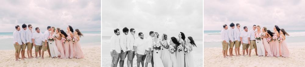 Destination Wedding Photography_Riu Palace Riviera Maya_Playa Del Carmen_Mexico_wedding party portrait on the beach_candid_Destination Wedding Photographer.jpg