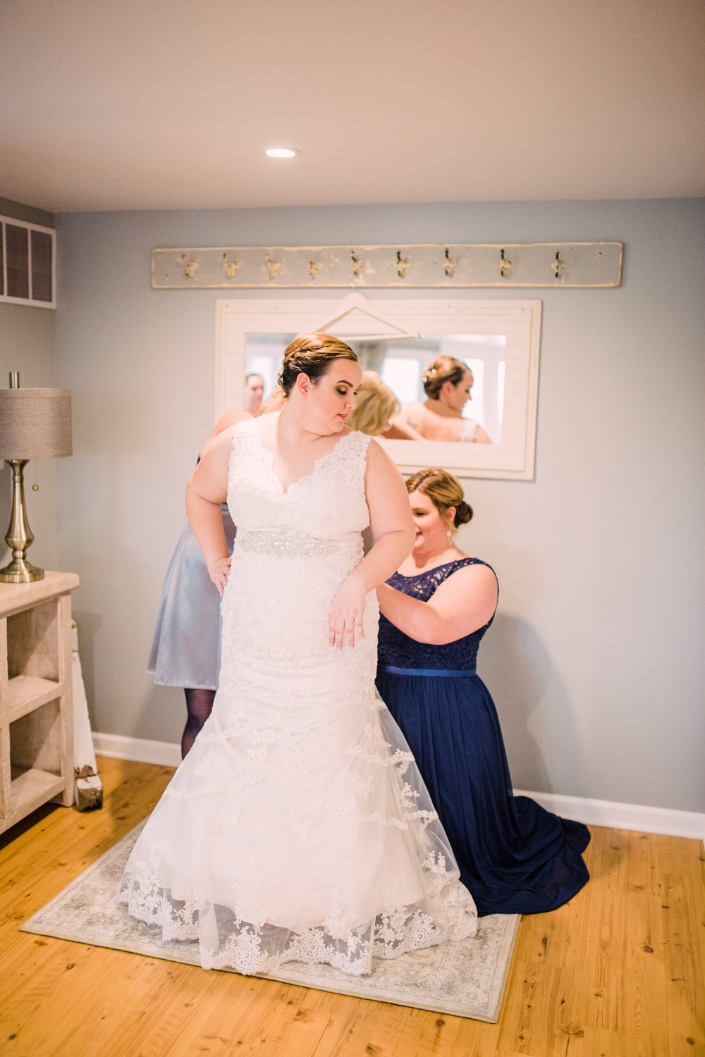 Wedding-Photography_Gatherings-by-Farmhouse-Catering_Nevada-Iowa_bride+getting+ready+with+maid+of+honor-iowa+wedding+photographer.jpg