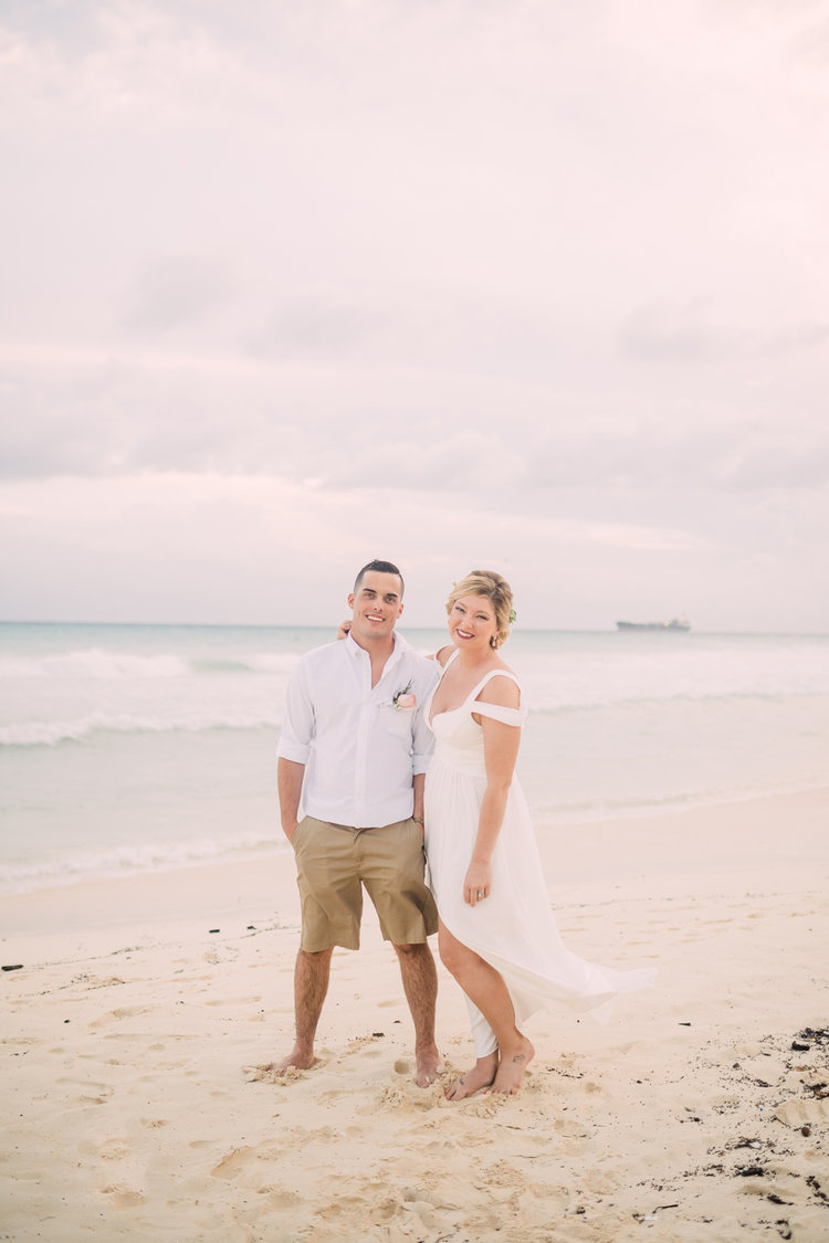 Destination-Wedding-Photography-Riu-Palace-Riviera-Maya-Playa-Del-Carmen-Mexico-bride-and-groom-on-the-beach-at-sunset-destination-wedding-photographer.jpg