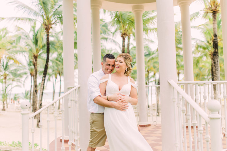 Destination-Wedding-Photography_Riu-Palace-Riviera-Maya_Playa-Del-Carmen-Mexico_Couple-embracing-in-gazebo-overlooking-the-ocean-destination+wedding+photographer.jpg