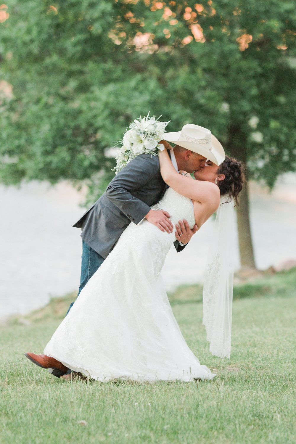 Wedding Photography-Kings Point Water Park-Clear Lake-Iowa-cowboy hat kissing-boho country-Iowa Wedding Photographer.jpg
