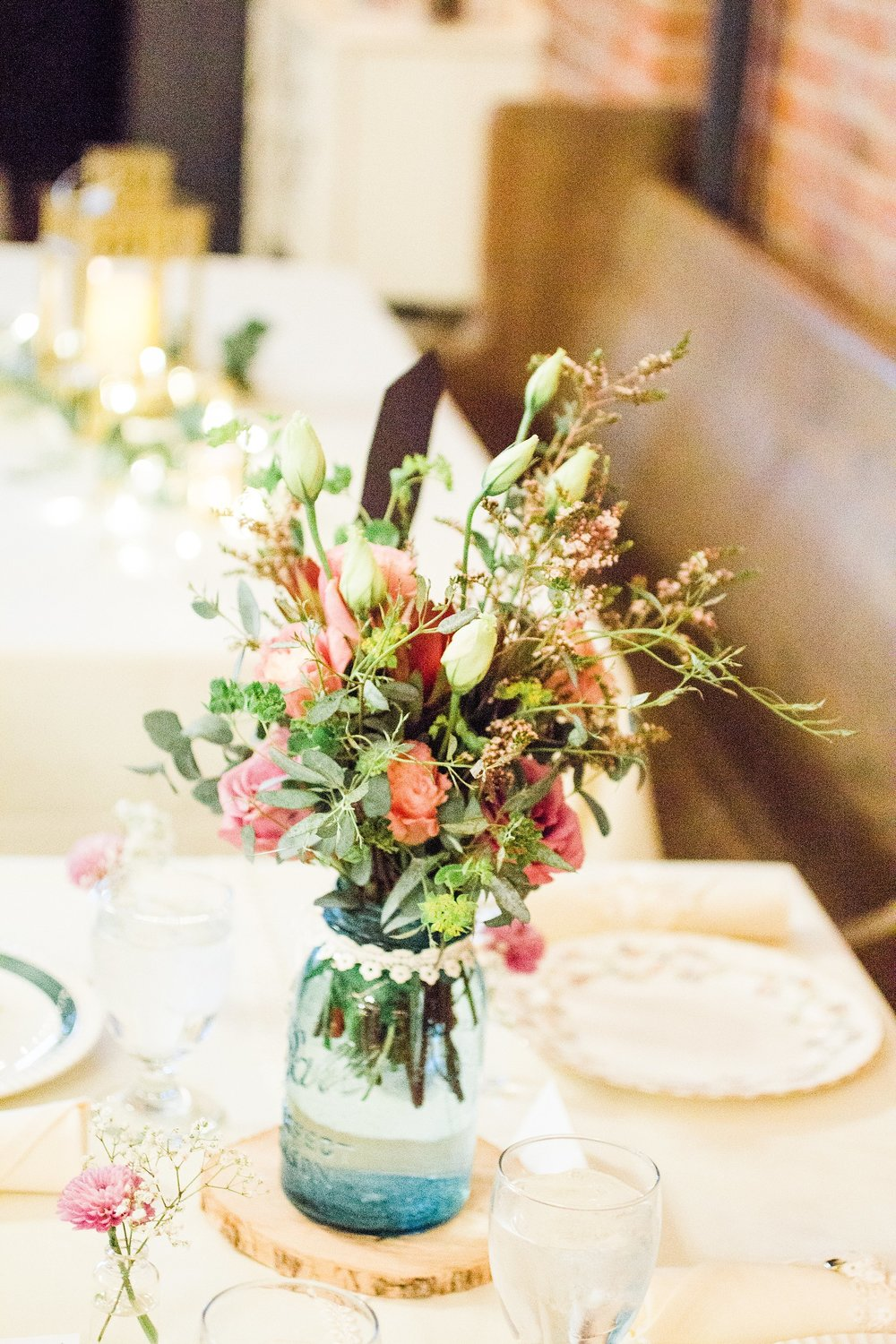 Wedding-Photography_Gatherings by Farmhouse Catering-Neveda-Iowa_vase with bouquet-iowa+wedding+photographer.jpeg