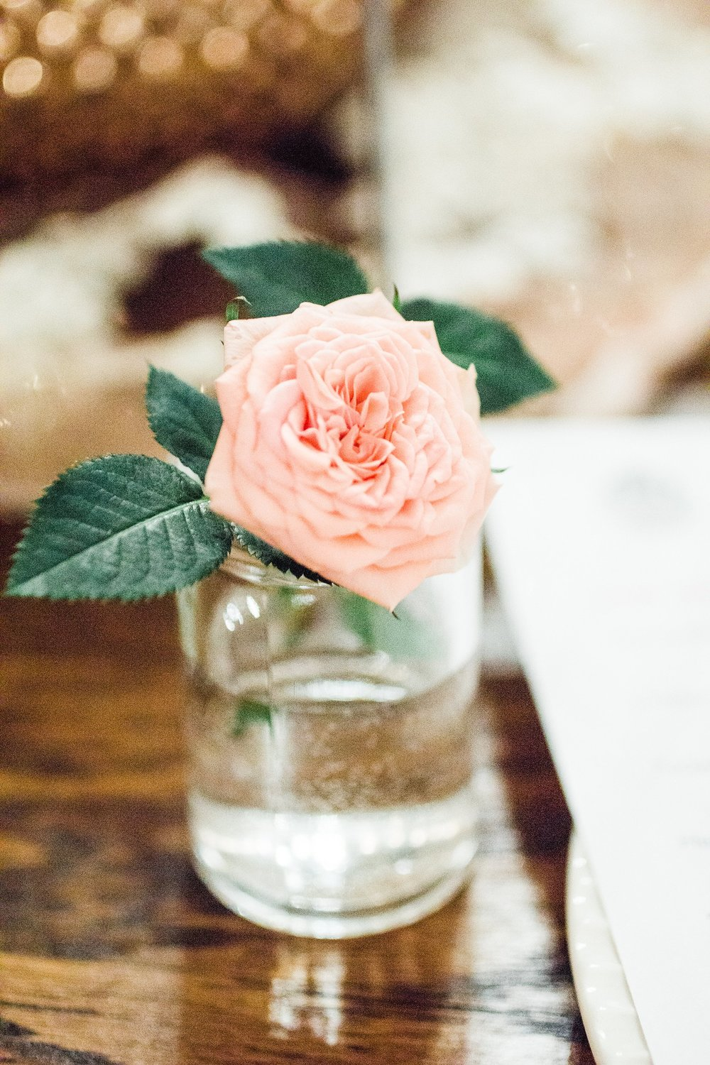 Wedding-Photography_Gatherings by Farmhouse Catering-Neveda-Iowa_vase with rose-iowa+wedding+photographer.jpeg
